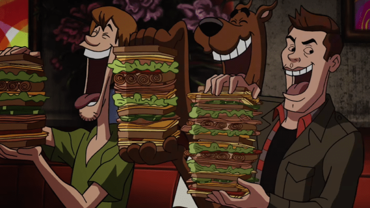 Salsicha, Scooby e Dean se entopem de sandubas em cena do crossover ScoobyNatural